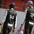Fernando Alonso and Esteban Ocon carrying helmets at the pre-season testing photoshoot. Bahrain March 2021.