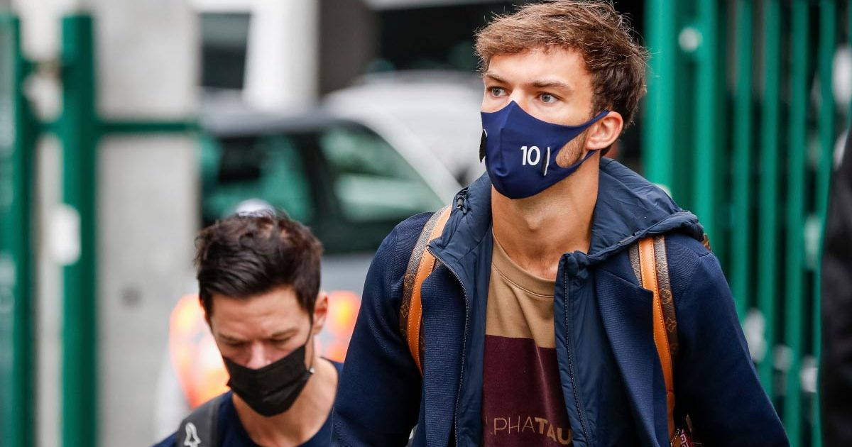 Pierre Gasly walks through the paddock at Spa.