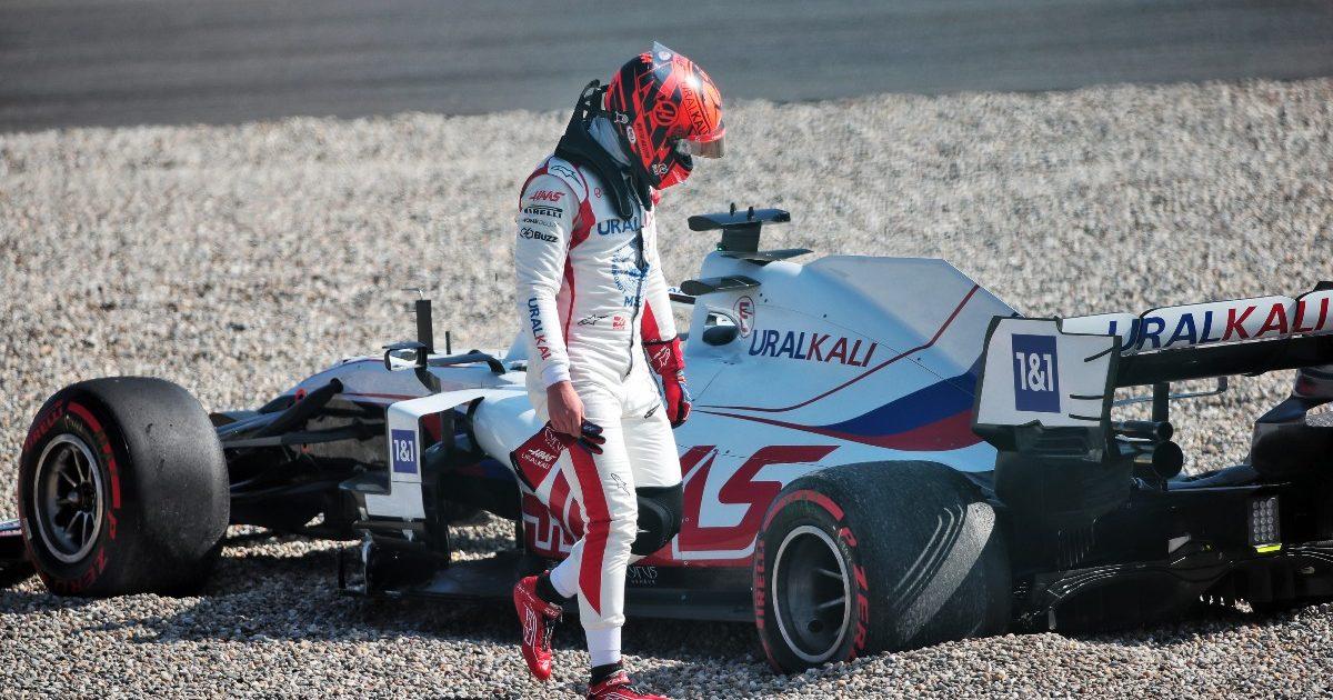 Nikita Mazepin walking away from his gravel-beached car. Netherlands September 2021