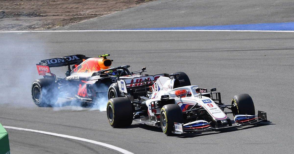 Sergio Perez locks up behind Nikita Mazepin during the Dutch GP. Zandvoort September 2021.