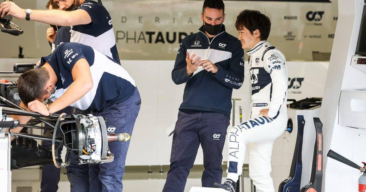 Yuki Tsunoda talks to an AlphaTauri engineer at the British GP. Silverstone July 2021.