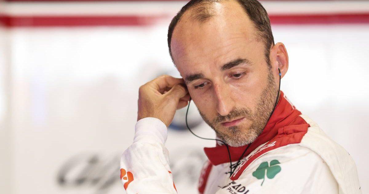 Robert Kubica touching earpiece in Alfa Romeo garage. Zandvoort September 2021.