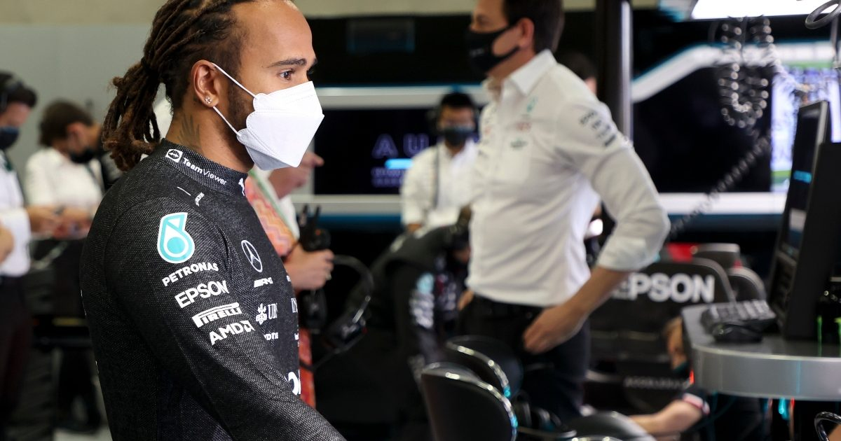 Lewis Hamilton and Toto Wolff standing in the Mercedes garage. Austria July 2021
