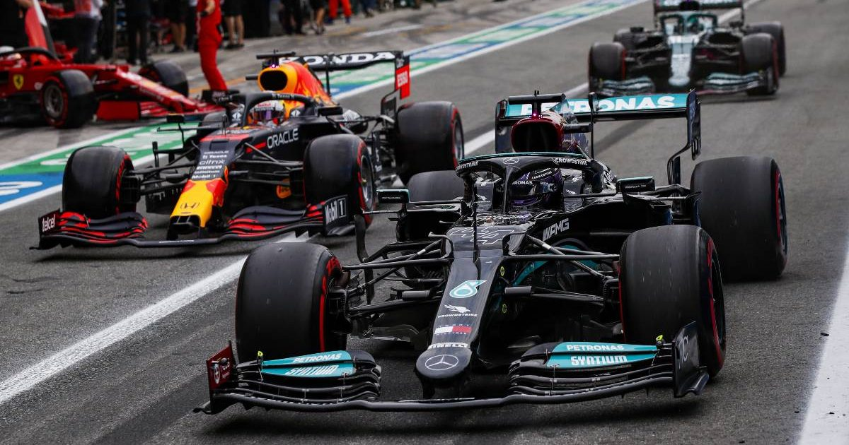 Max Verstappen [Red Bull] and Lewis Hamilton [Mercedes] in the pit lane at the Italian GP. September 2021.