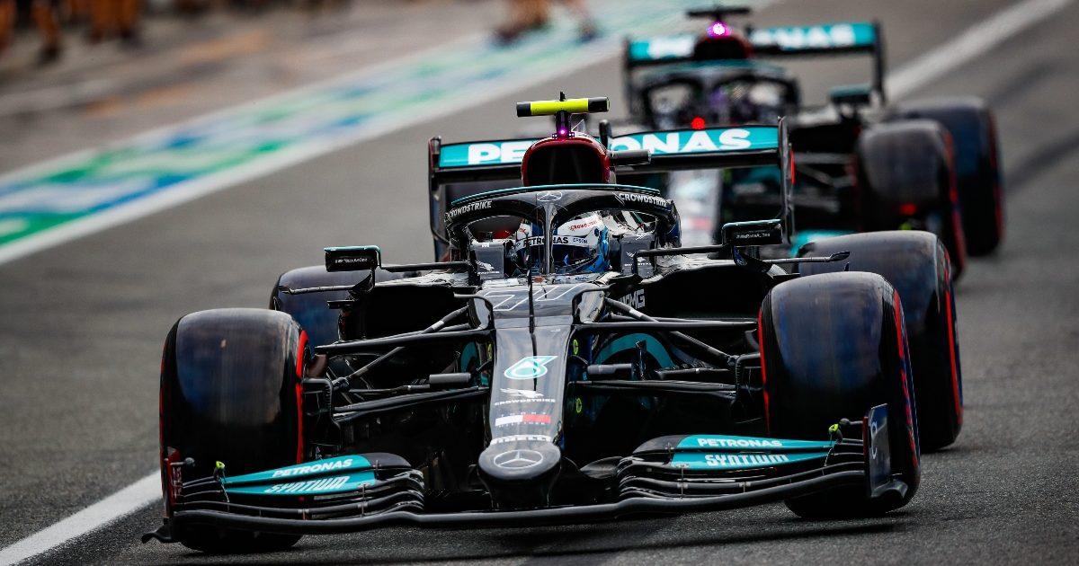 Valtteri Bottas and Lewis Hamilton leave the pit-lane. Italy September 2021