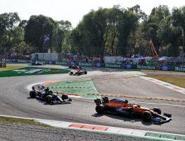 Lando Norris holds off Lewis Hamilton. Italy September 2021