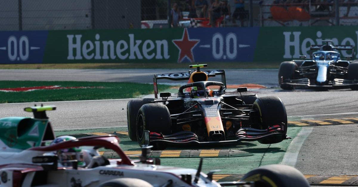 Red Bull's Sergio Perez drives over the kerbs at Monza. Italy, September 2021.