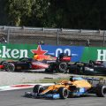 Lewis Hamilton and Max Verstappen in the gravel as Daniel Ricciardo drives past. Monza September 2021.