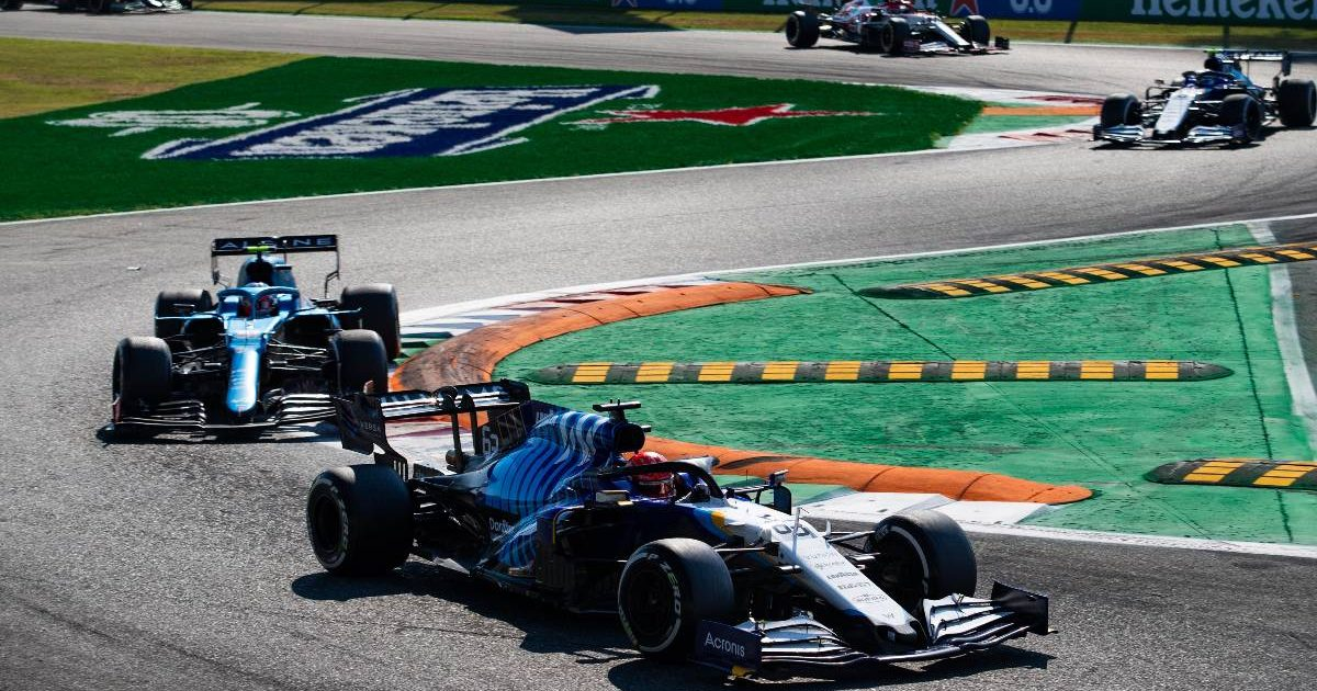 George Russell ahead of an Alpine through the first chicane in the Italian GP. Monza September 2021.