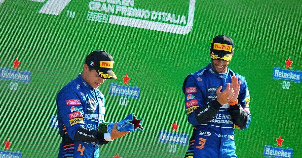 Lando Norris and Daniel Ricciardo receive their trophies after the Italian Grand Prix. Italy September 2021