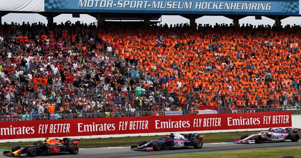 Max Verstappen leads cars past a grandstand during the German GP. Hockenheim July 2019.