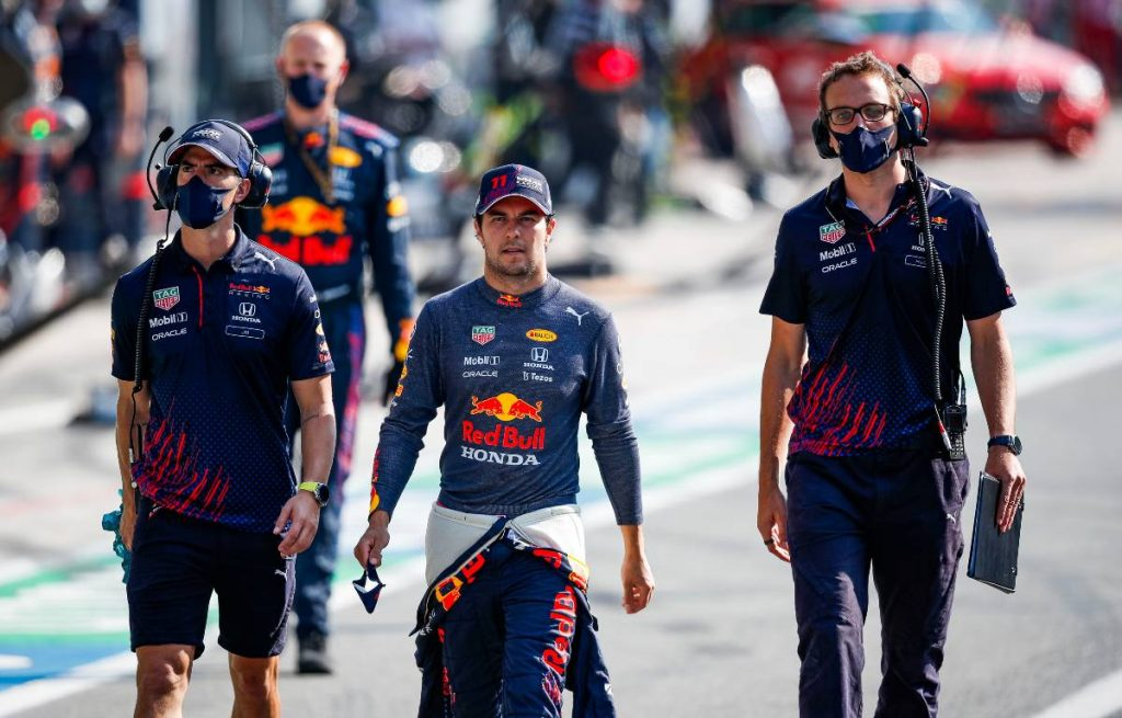 Sergio Perez with Red Bull colleagues in the pit lane. Monza September 2021.