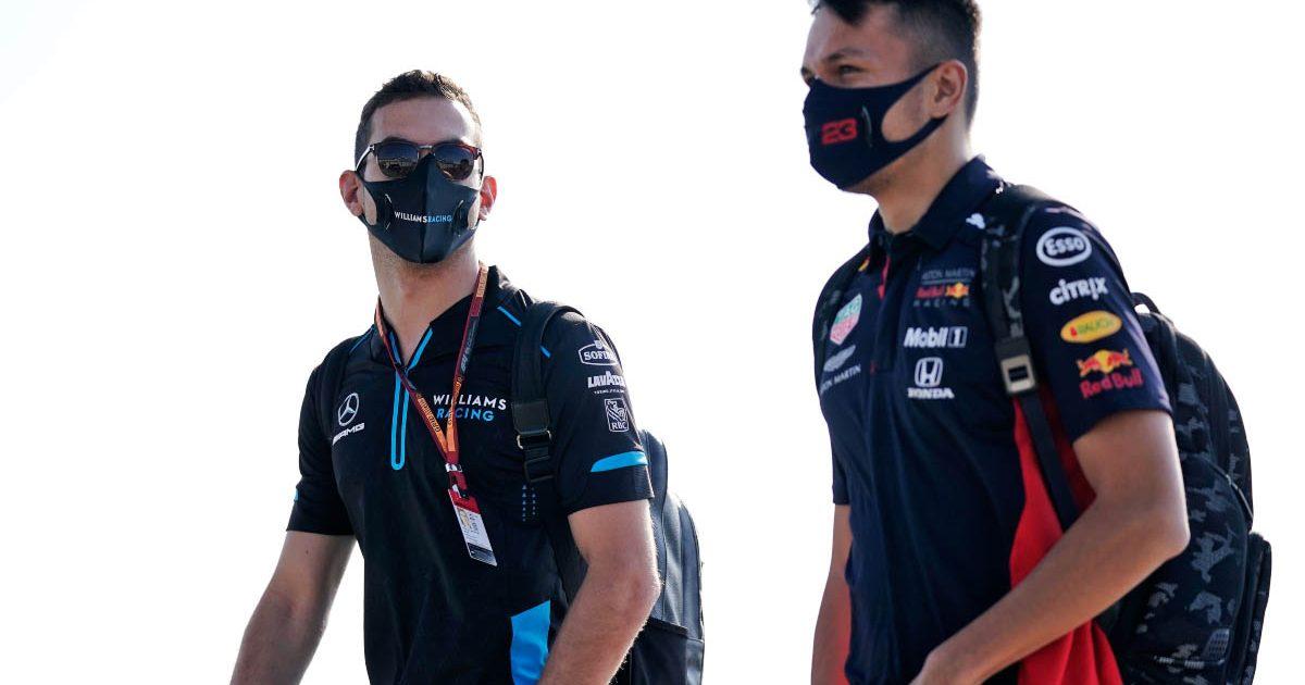Nicholas Latifi and Alex Albon walk together at Silverstone.