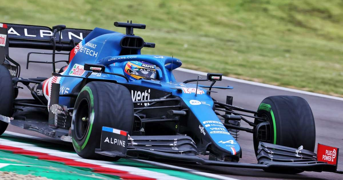 Fernando Alonso drives his Alpine at Imola on intermediate tyres.