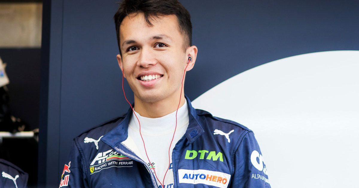 Alex Albon smiles in his DTM garage. September 2021.