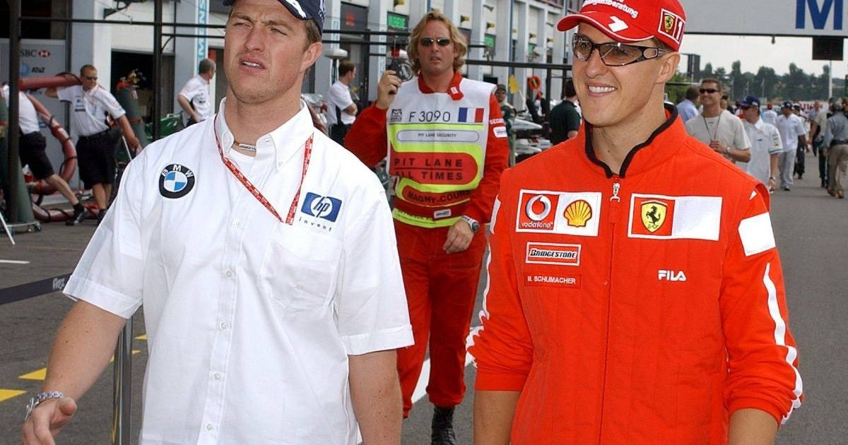 Ralf Schumacher and Michael Schumacher at the French GP. Magny-Cours July 2002.