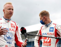 Haas driver Nikita Mazepin speaks with Mick Schumacher standing behind him. Britain July 2021