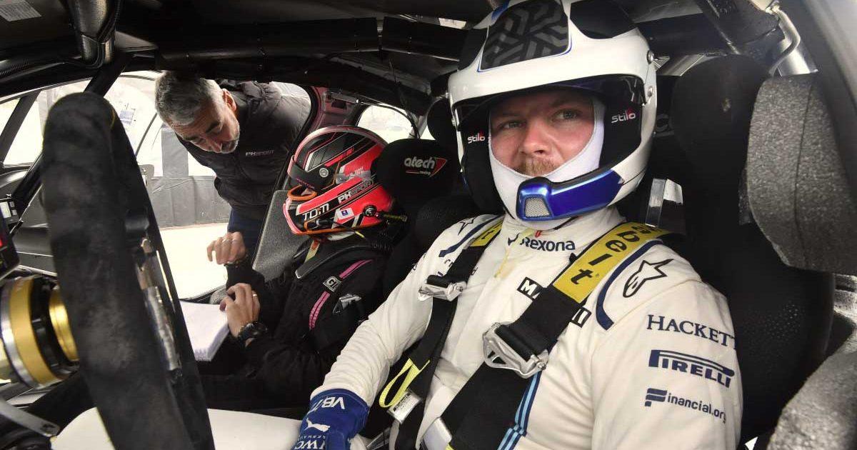 Valtteri Bottas behind the wheel of a rally car.