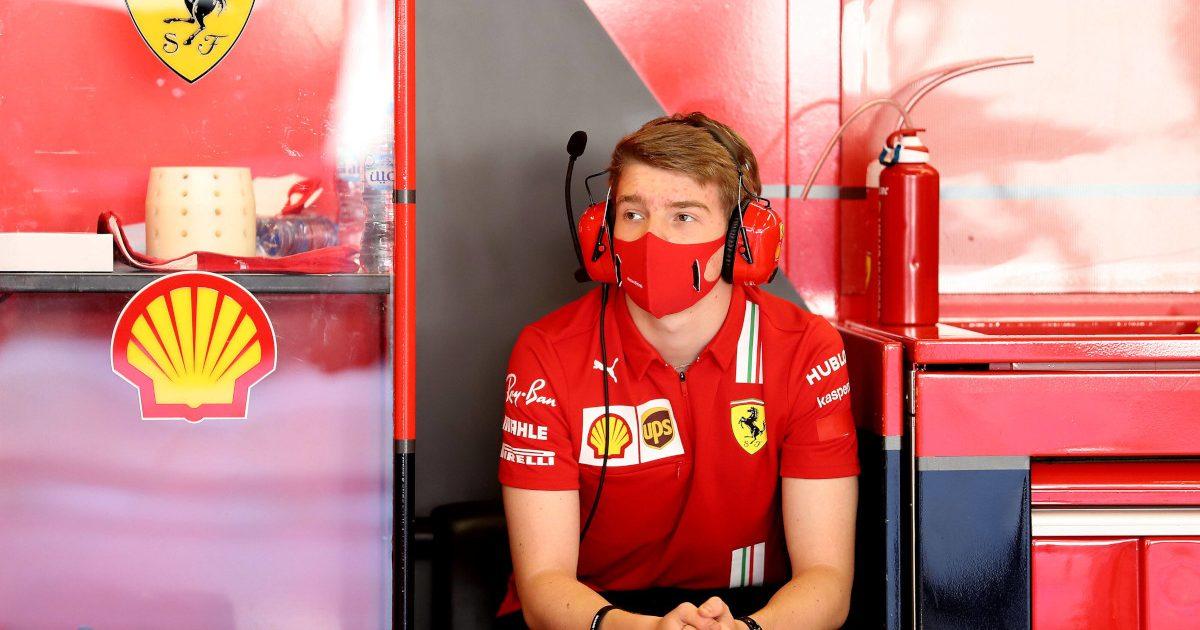 Robert Shwartzman sitting with Ferrari. Abu Dhabi December 2021