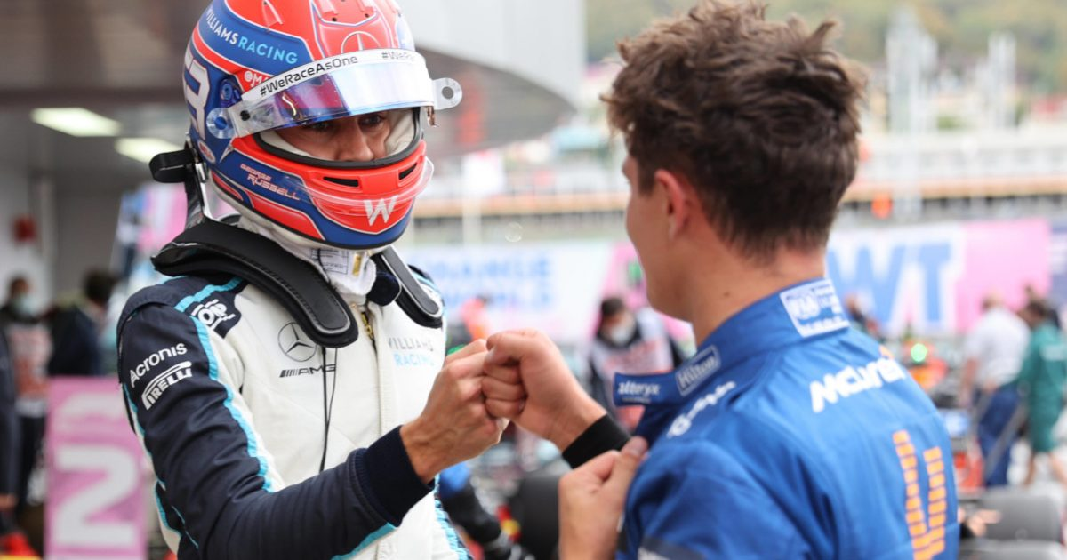 George Russell fist bumps with Lando Norris. Russia September 2021