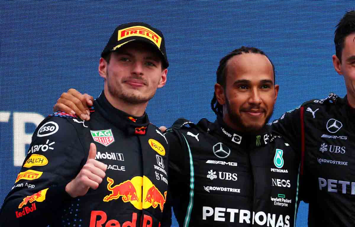 Max Verstappen and Lewis Hamilton on the podium at Sochi.