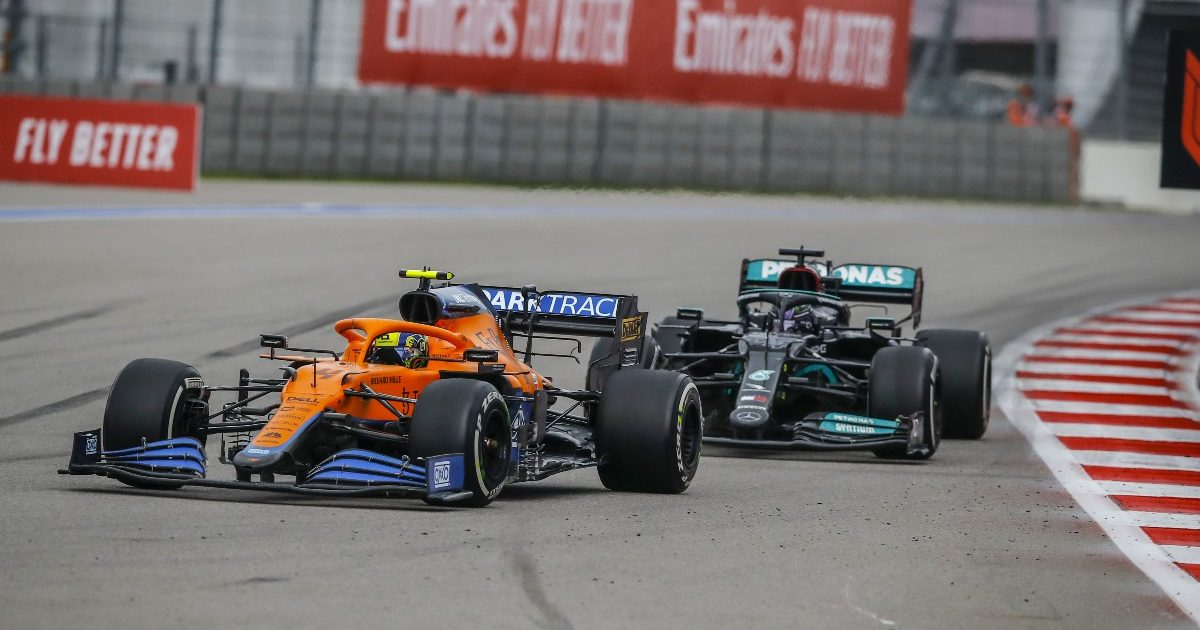 Lando Norris defends the Russian GP lead from Lewis Hamilton. September 2021.
