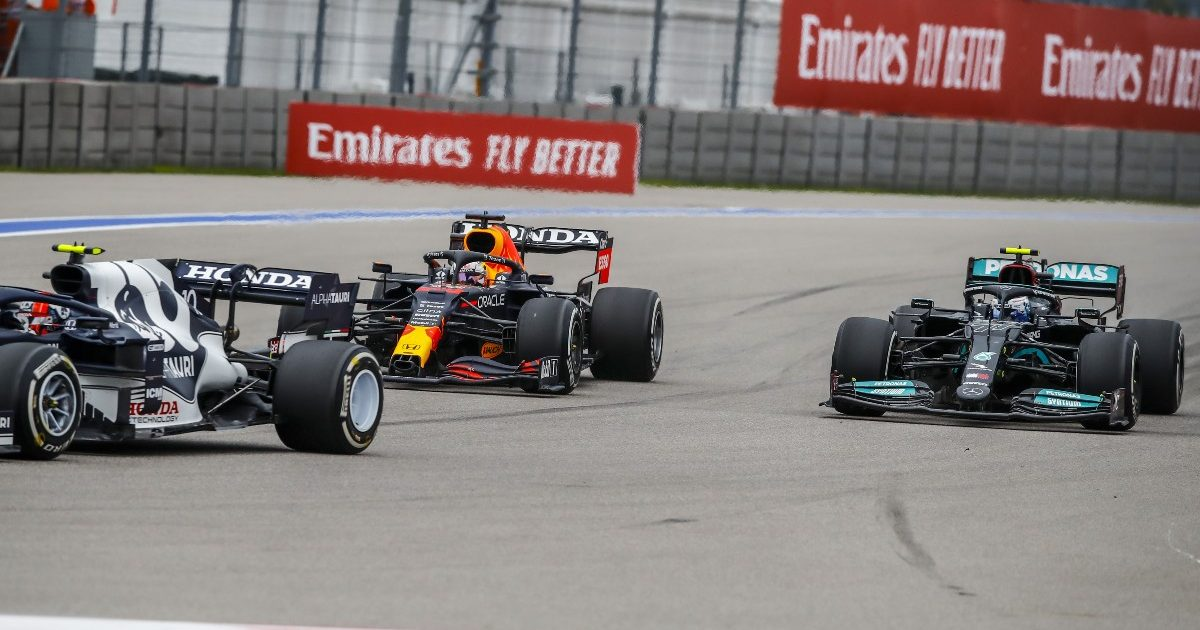 Max Verstappen passes Valtteri Bottas in the Russian Grand Prix. September 2021.