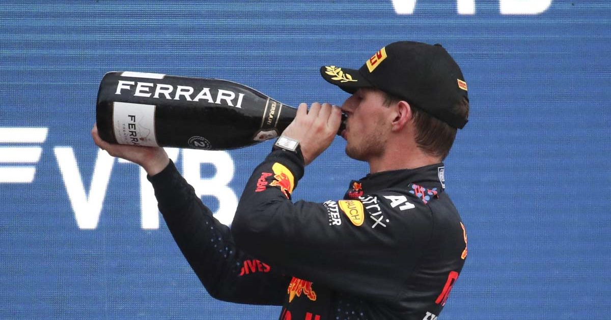 Max Verstappen drinks champagne in Russia.
