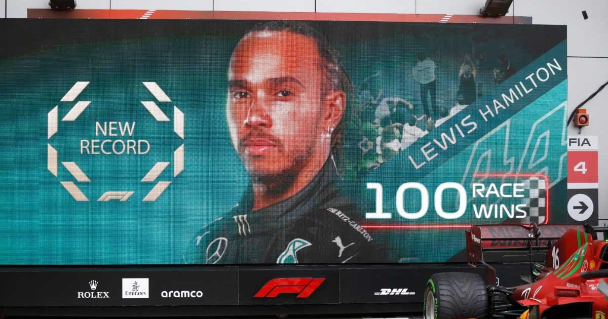 A board shows a graphic as Lewis Hamilton wins his 100th race at the Russian GP.