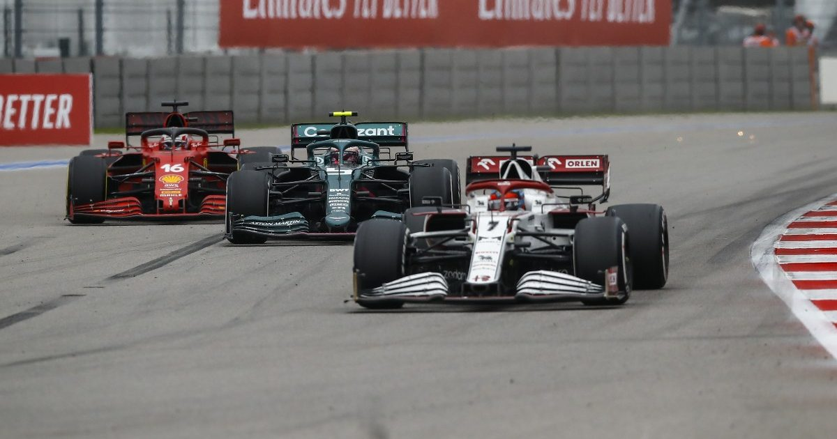 Kimi Raikkonen, Alfa Romeo, leads an Aston Martin and a Ferrari. Russia, September 2021.