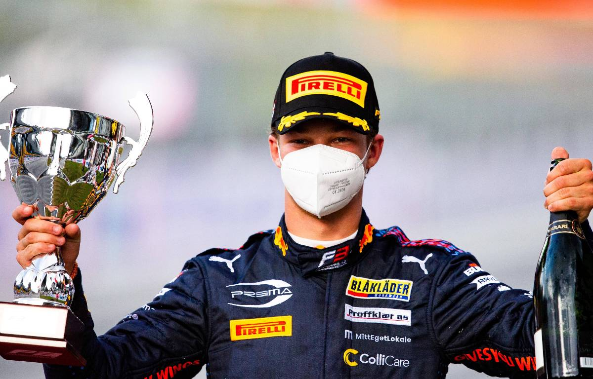Red Bull's Dennis Hauger celebrates victory. Austria, July 2021.