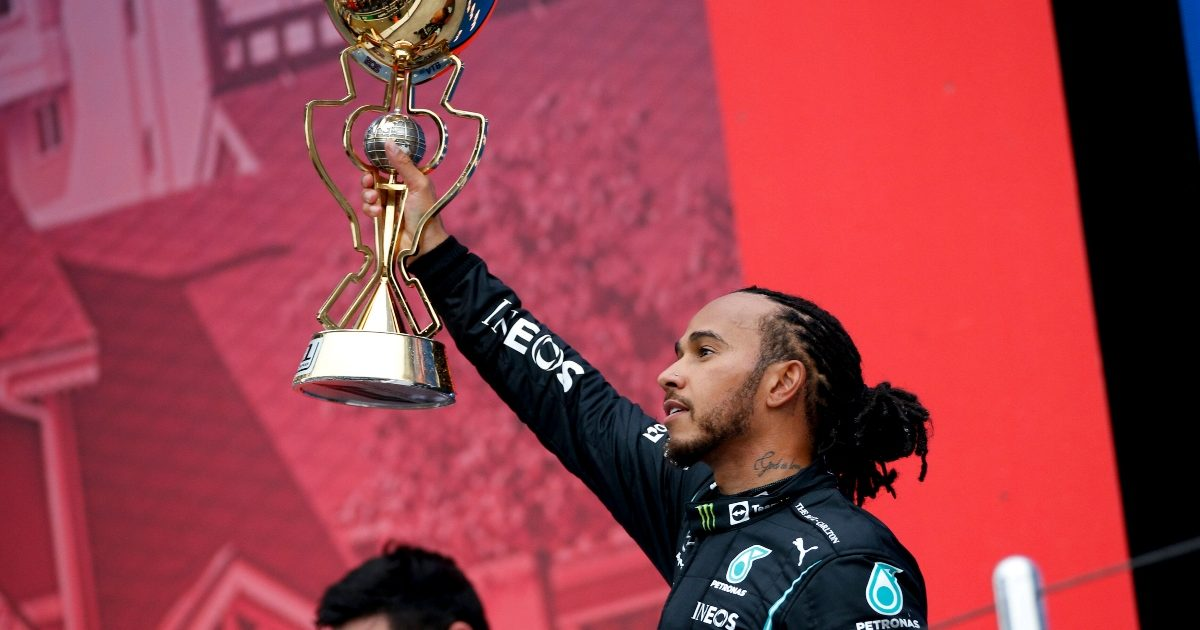 Lewis Hamilton lifting the trophy after winning in Sochi. Russia September 2021