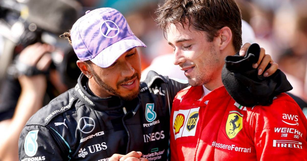 Lewis Hamilton shakes hands with Charles Leclerc. Silverstone July 2021.
