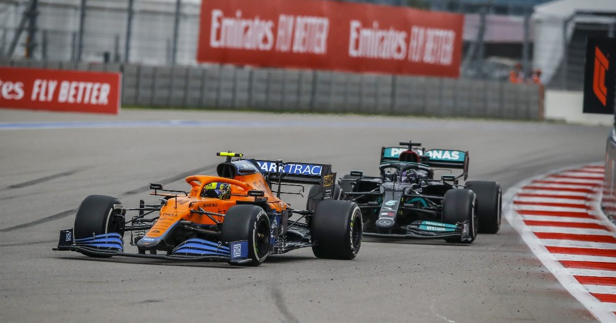Lando Norris and Lewis Hamilton racing at Sochi. Russia September 2021