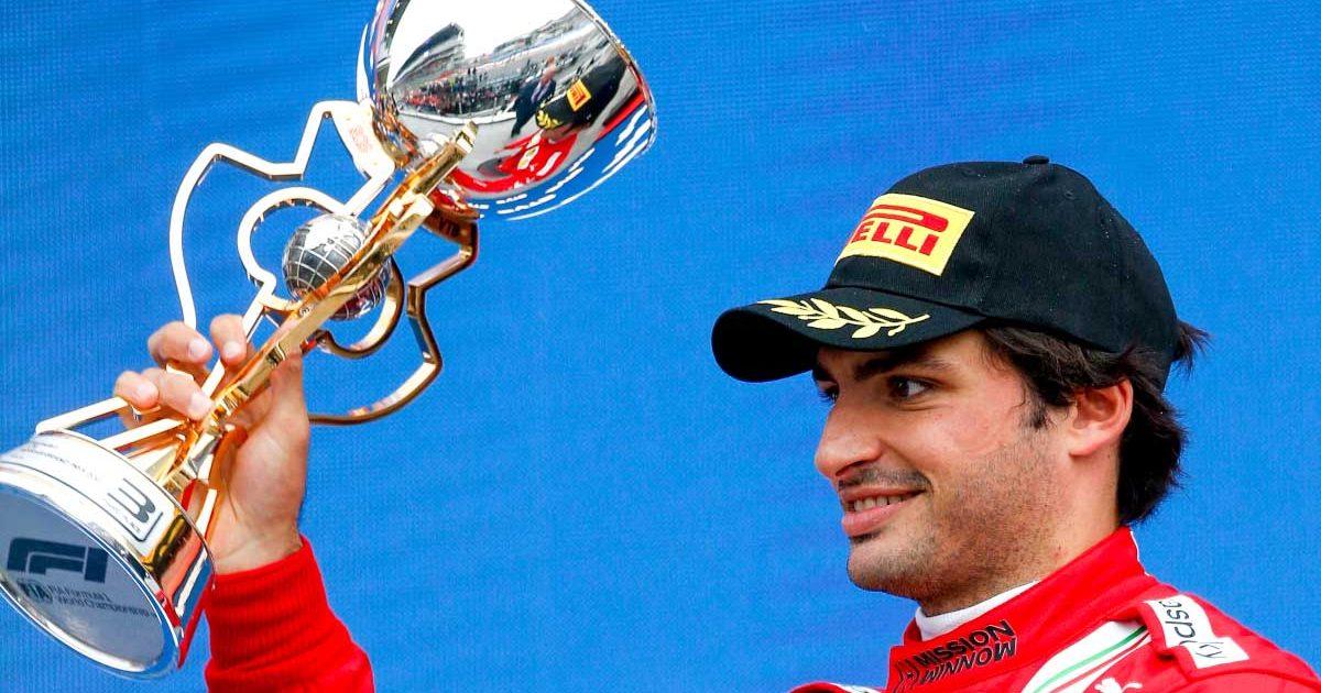 Ferrari driver Carlos Sainz on the podium in Sochi.