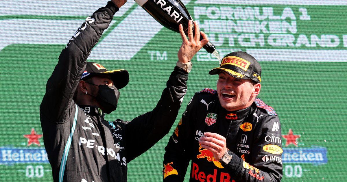 Lewis Hamilton pours champagne over Max Verstappen. Netherlands September 2021