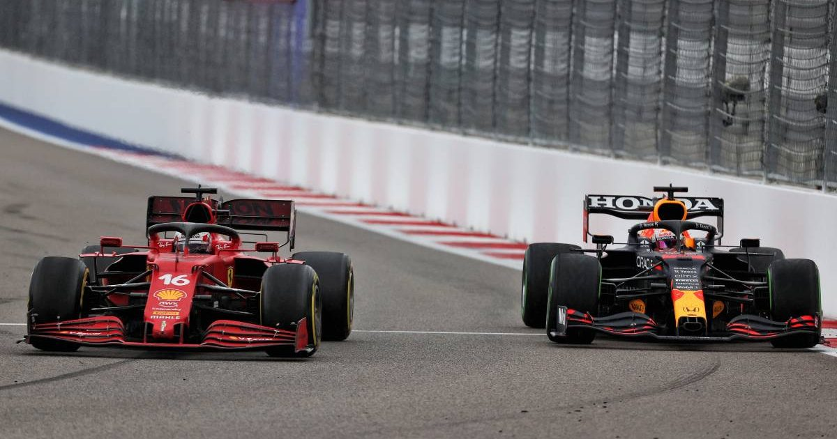 Charles Leclerc's Ferrari alongside Max Verstappen's Red Bull during the Russian GP. Sochi September 2021.