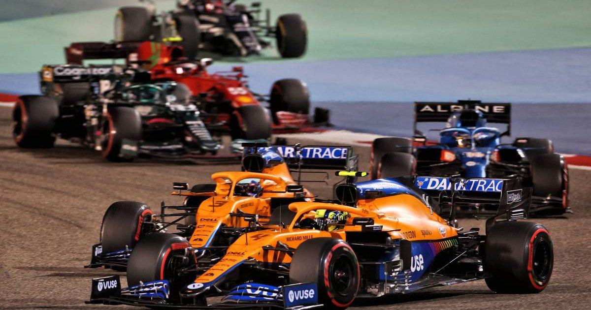 Lando Norris and Daniel Ricciardo vie during the Bahrain GP. Sakhir March 2021.