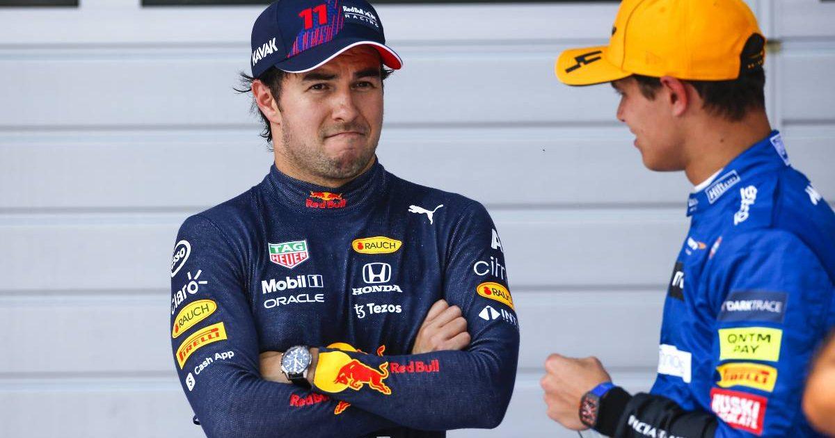 Sergio Perez and Lando Norris talk in Austria. July 2021.