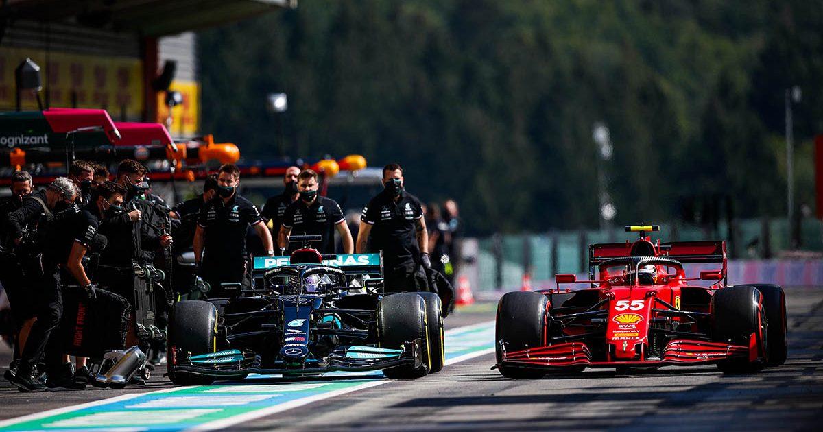 Lewis Hamilton in the pit lane alongside a Ferrari. Spa, August 2021