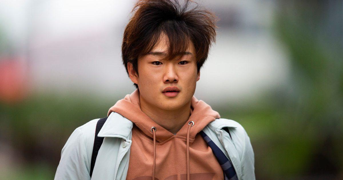 Yuki Tsunoda walks through the paddock in Sochi.