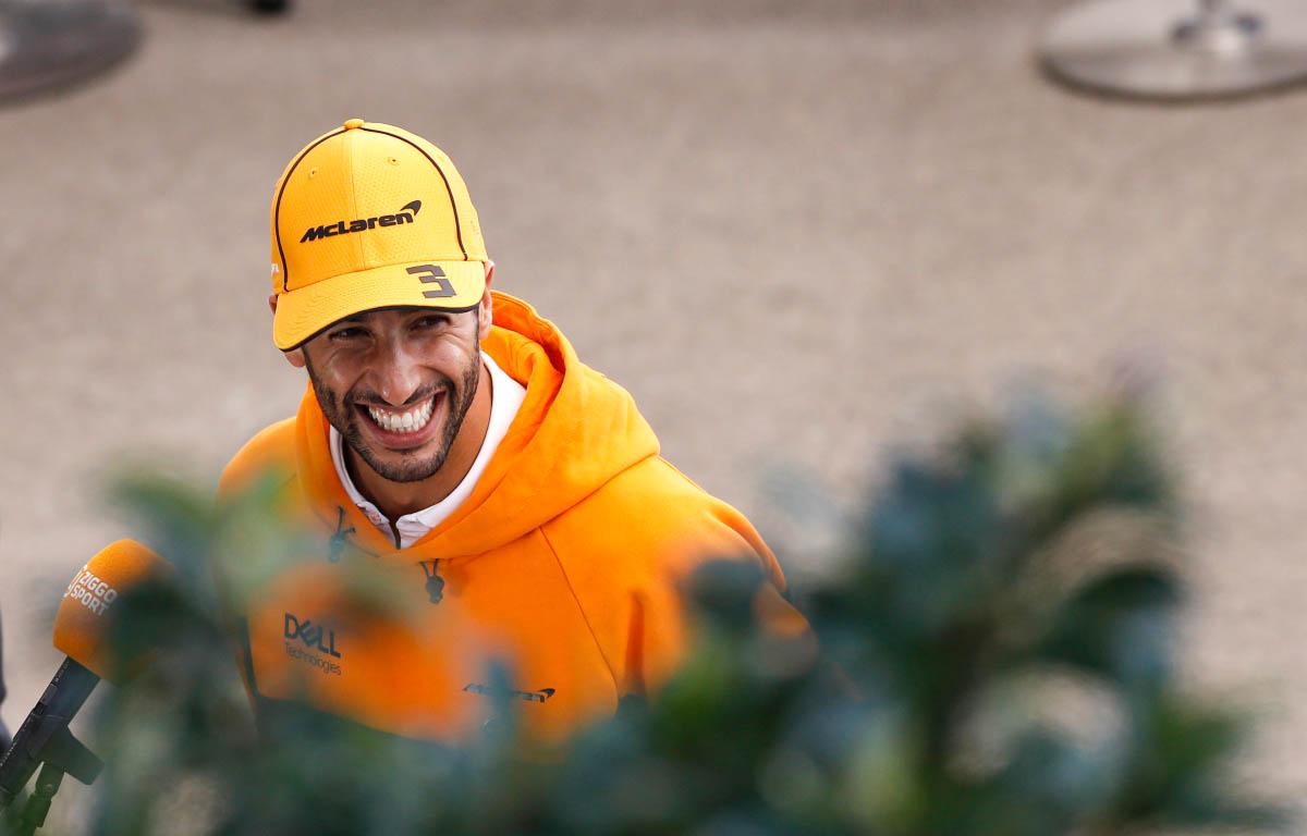 Daniel Ricciardo smiles during an interview.