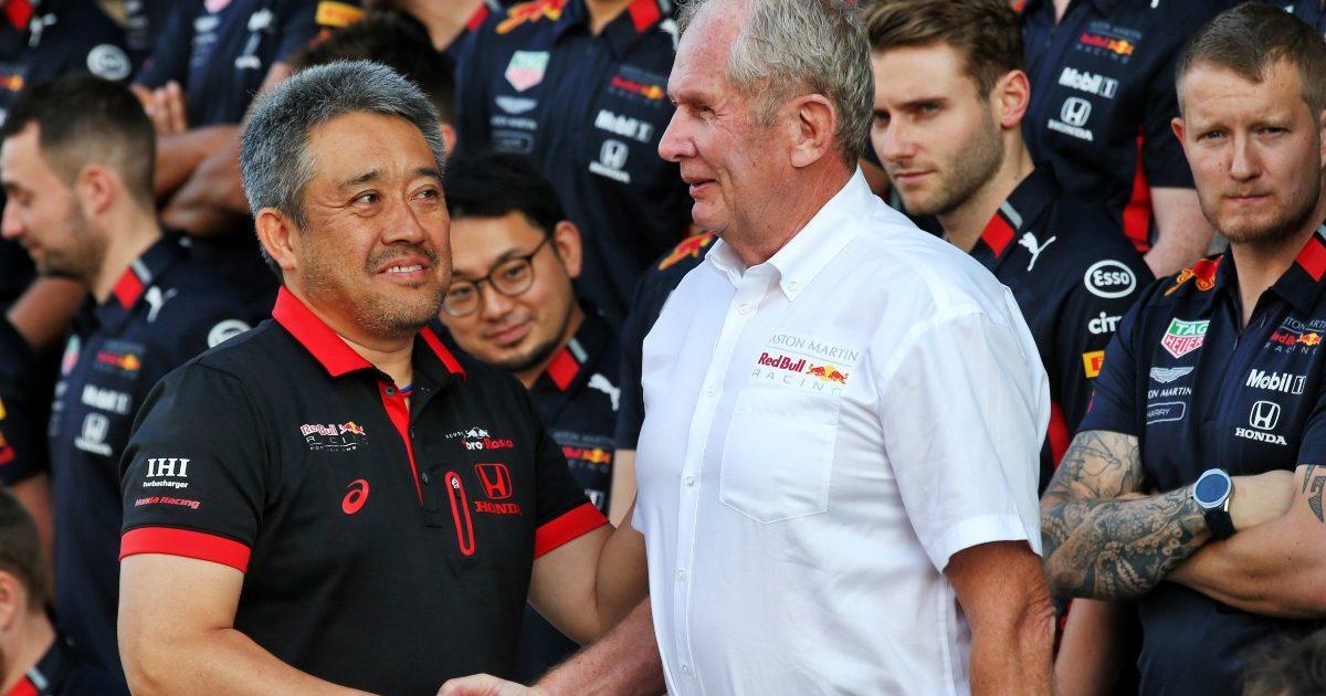 Masashi Yamamoto, Honda, shakes the hand of Helmut Marko. Abu Dhabi, November 2019.