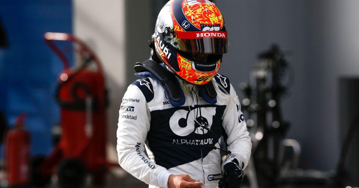 Yuki Tsunoda walks through the paddock. Istanbul October 2021.