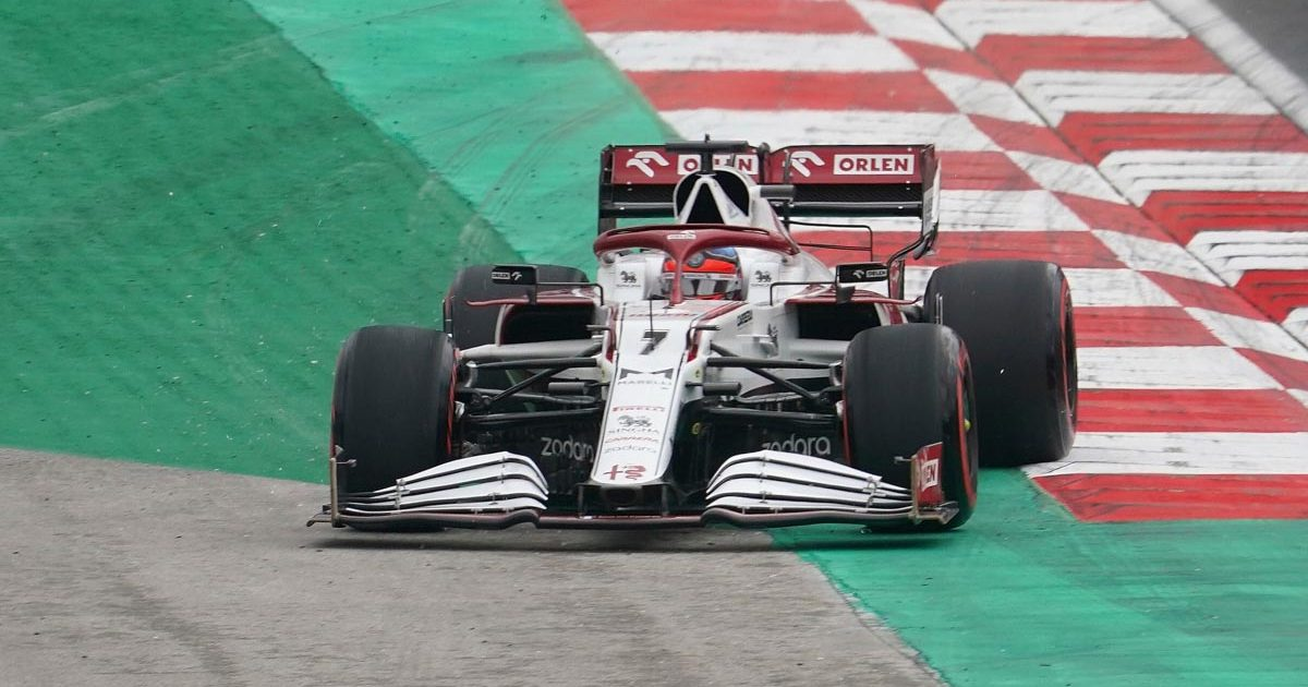 Kimi Raikkonen runs wide at Turn 1 in his Alfa Romeo. Istanbul October 2021.