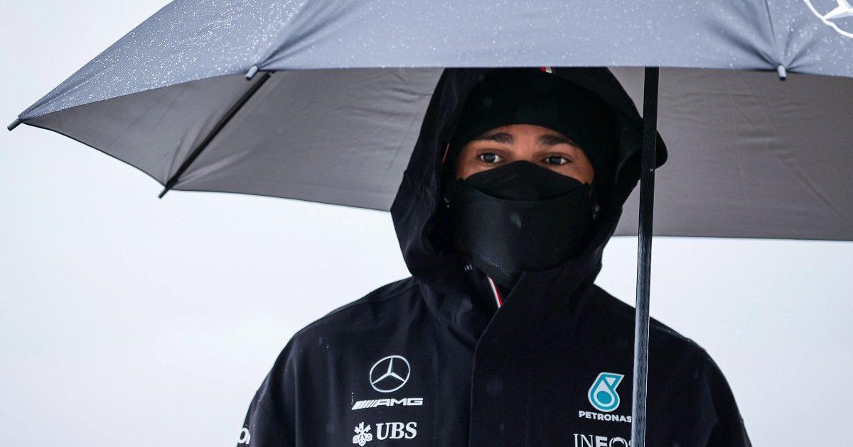 Lewis Hamilton, Mercedes, with an umbrella. Turkey, October 2021.