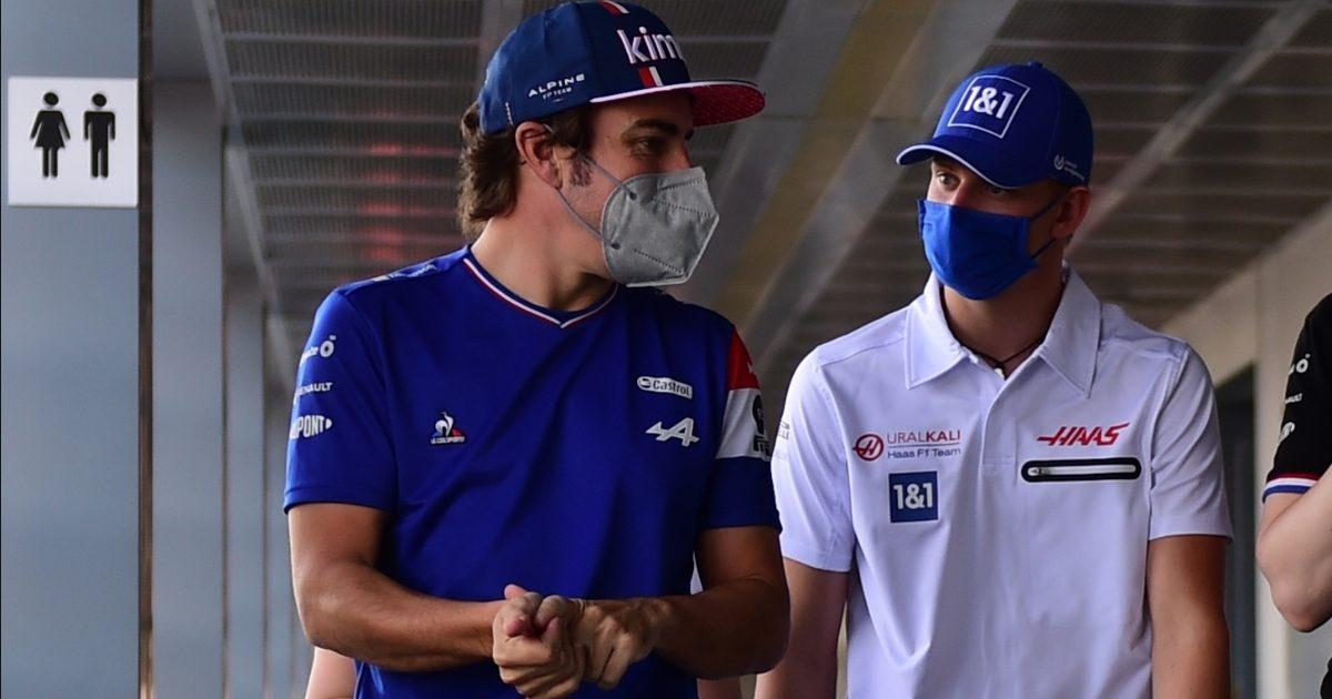 Fernando Alonso and Mick Schumacher walking. Italy September 2021
