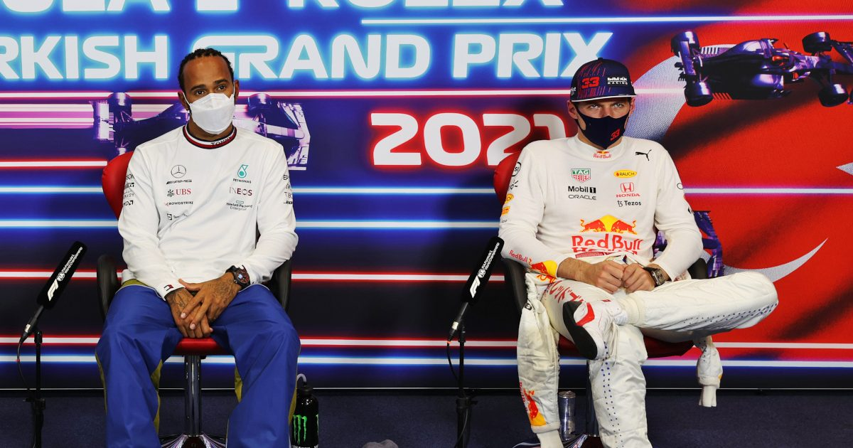 Lewis Hamilton and Max Verstappen in white at the press conference. Turkey October 2021