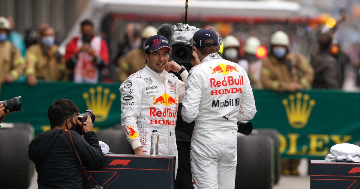 Red Bull drivers Max Verstappen and Sergio Perez talking. Turkey October 2021